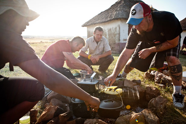 Justin Bonello braaing with mates on the Ultimate Braai Master