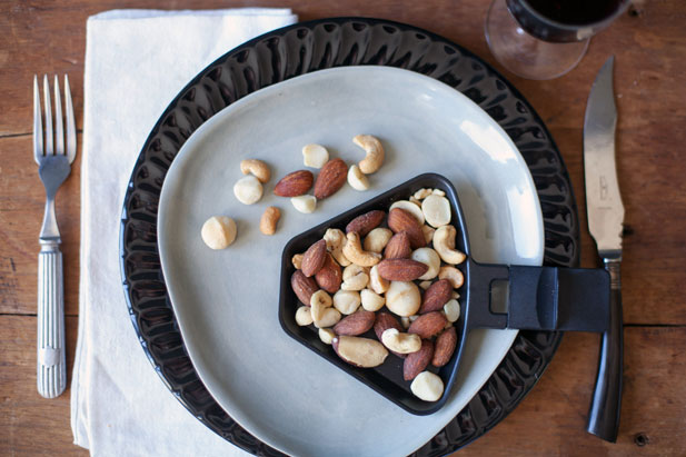 Macadamia and walnuts roasted on the raclette