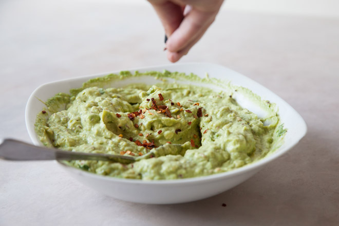 mixing guacamole ingredients