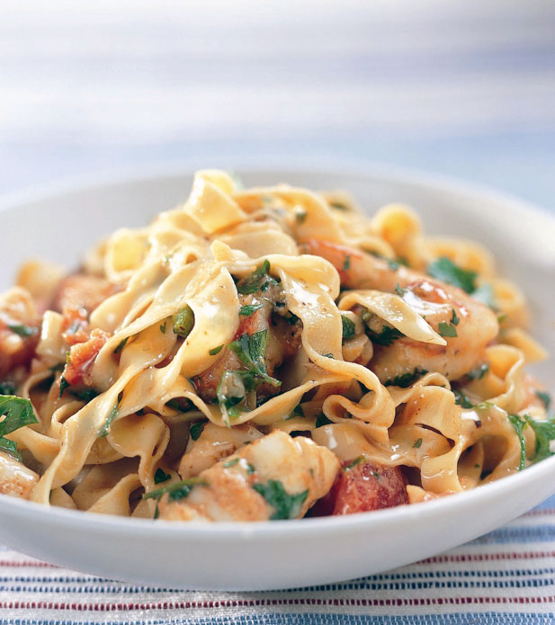 Tagliatelle with prawns, squid and tomato